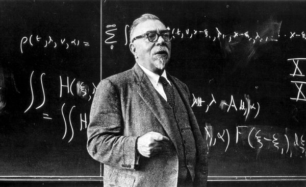 Norbert Wiener (1894-1964), an American mathematician, at the blackboard. MIT Archives