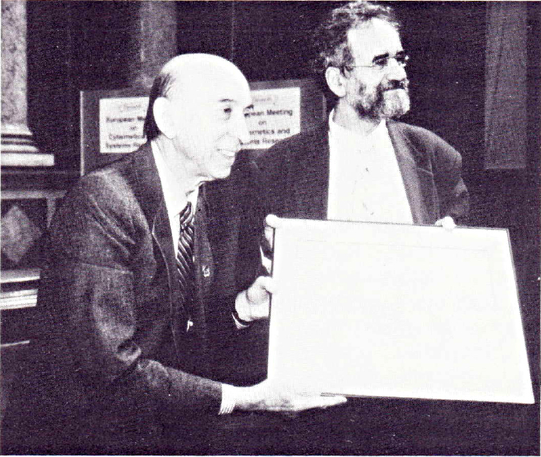 Prof. Lofti Zadeh (left) receiving an award from Prof. Robert Trappl at the EMCSR92 photo: Stephen Sokoloff, IFSR Newsletter 1993 Vol 13 No 1 (32)